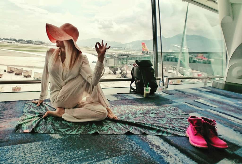Lord of the Fishes Yoga Pose Meditation Breathing - Hong Kong Airport - Travel Health