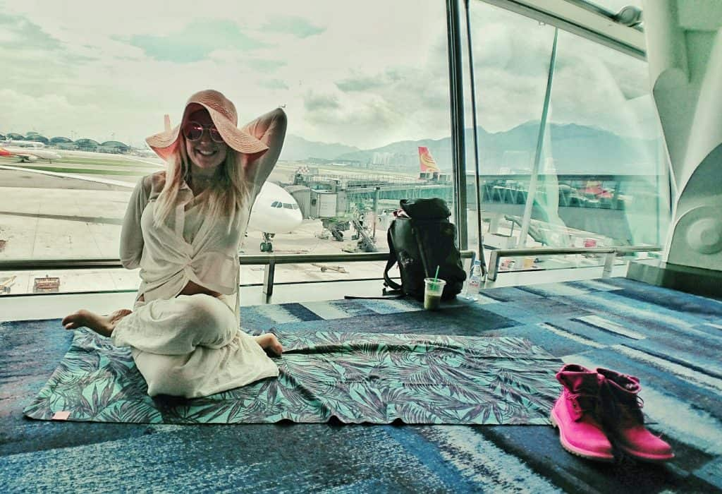 Cow Face Yoga Pose Meditation Breathing - Hong Kong Airport - Happy Travel Health ways to stay healthy