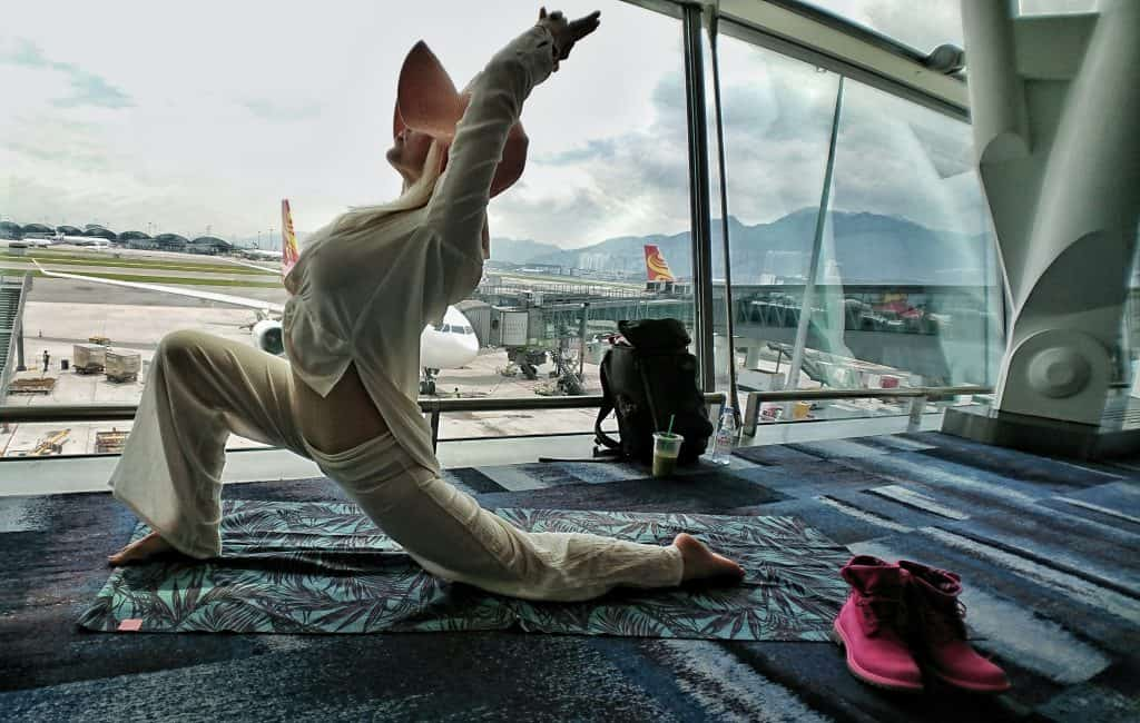 High Lunge Crescent Moon Yoga Pose Meditation Breathing - Hong Kong Airport - Happy Travel Health ways to stay healthy