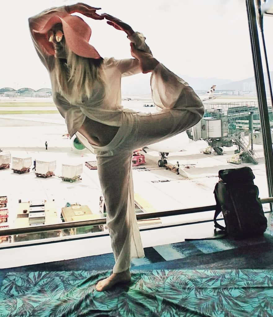 Standing Mermaid Yoga Pose Meditation Breathing - Hong Kong Airport - Happy Travel Health ways to stay healthy
